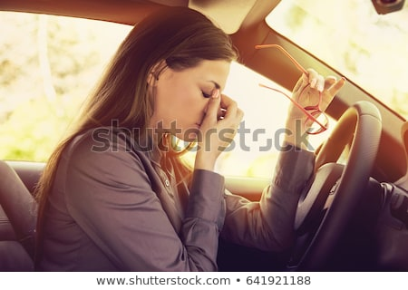 Stockfoto: Business Woman Having Headache Taking Off Her Glasses Has To Make A Stop After Driving Car On Rush H
