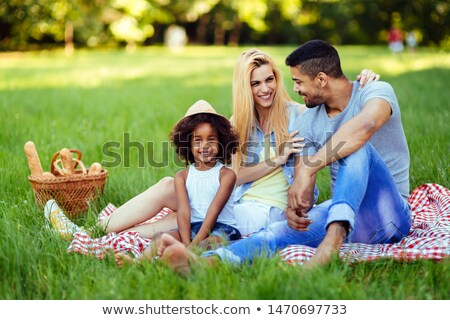 Couple have a picnic in a field Stock photo © IS2