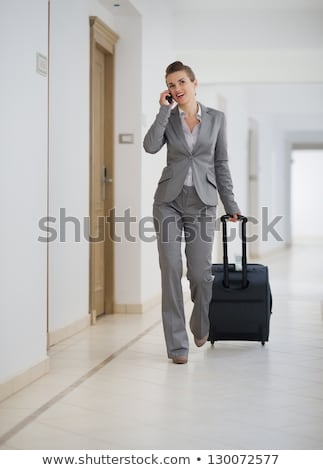 Woman with luggage and cellular phone Stock photo © IS2