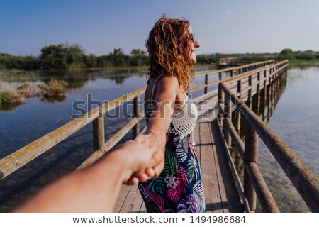 Stok fotoğraf: Adam · kadın · el · ele · tutuşarak · iskele · seyahat · deniz · feneri