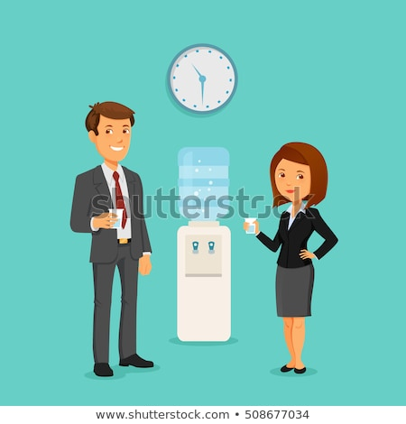 man and woman standing by water cooler stock photo © is2