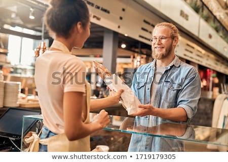 Femme souriante client boulangerie affaires femme travail Photo stock © IS2