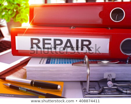 Repair on Red Ring Binder. Blurred, Toned Image. Stock photo © tashatuvango