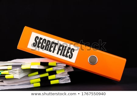 yellow office folder with inscription secrets stock photo © tashatuvango