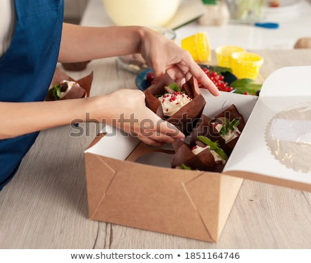 A female chef holding a pastry desert Stock photo © IS2