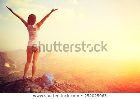 Woman hiker with arms outstretched enjoy mountains stock photo © blasbike