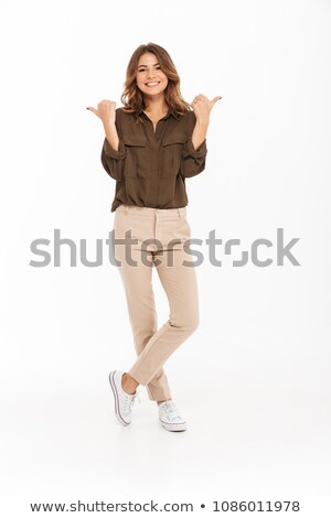 Portrait of a happy pretty girl pointing fingers both ways Stock photo © deandrobot