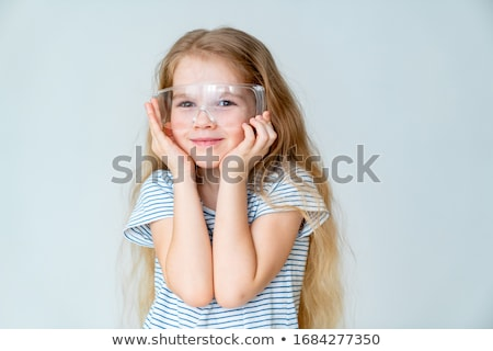 Menina óculos de proteção ciência sala de aula adolescente Foto stock © IS2