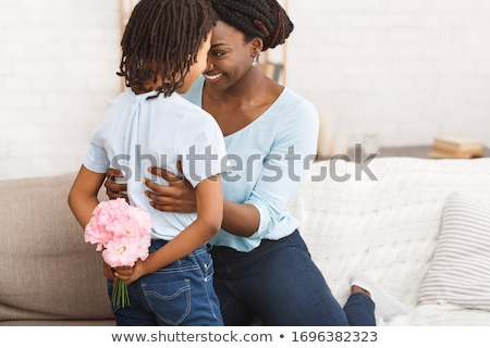 Smiling woman holding a bunch of flowers Stock photo © wavebreak_media