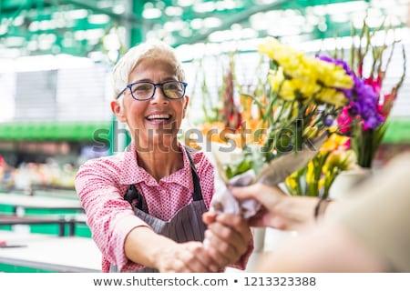 Idős nő virágok helyi virág piac Stock fotó © boggy