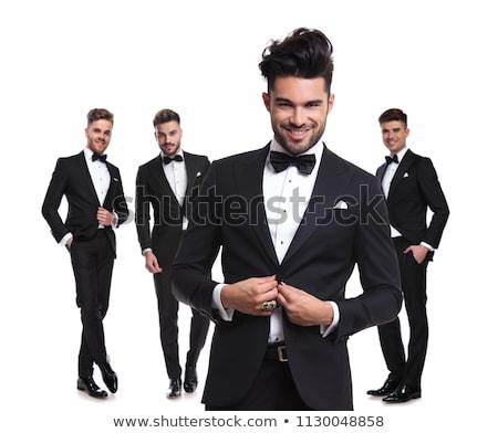 smiling elegant man holding his tuxedo's button Stock photo © feedough