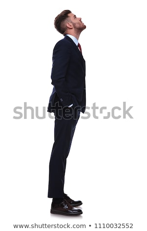 young businessman waiting in line looks up at something Stock photo © feedough