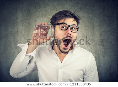 Excited man eavesdropping with glass jar  Stock photo © ichiosea