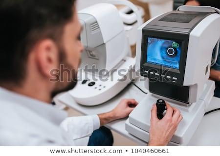 Fiatal nő férfi orvos szemorvos kórház férfi laptop Stock fotó © Elnur