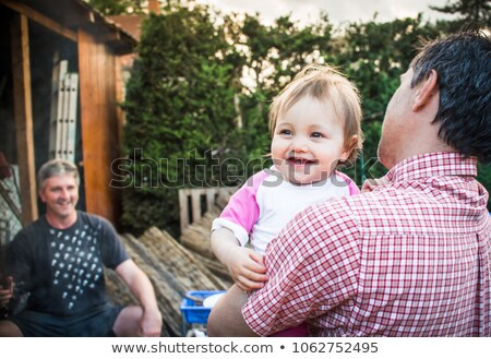 little red haired baby girl and father at home Stock photo © dolgachov
