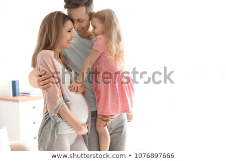 Stock photo: Pregnant Mother and her husband on baby room