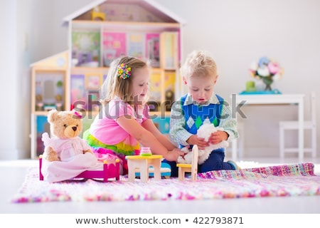 the boy plays with girl toys and dolls stock photo © galitskaya