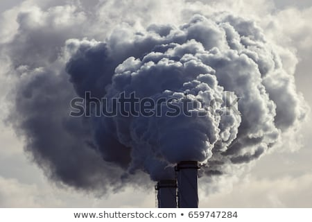 Air pollution with smoke from factory chimneys Stock photo © manfredxy