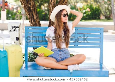 joli · jeune · femme · séance · plage · roches · soleil - photo stock © dashapetrenko