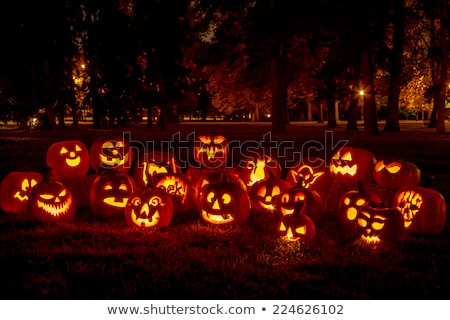 Scary Halloween Evening With A Glowing Pumpkin Lantern Stock photo © solarseven