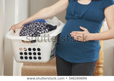Donna incinta lavanderia home baby donne Foto d'archivio © HighwayStarz