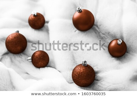 Chocolate brown Christmas baubles on white fluffy fur backdrop,  Stock photo © Anneleven
