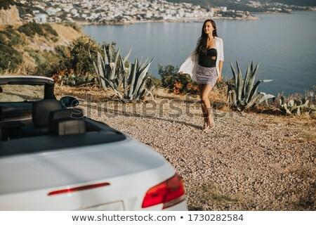 Młoda kobieta spaceru kabriolet samochodu dość Zdjęcia stock © boggy