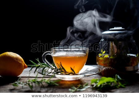 Gyógynövény tea teáskanna csésze fa asztal felső kilátás Stock fotó © karandaev