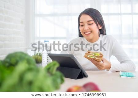 alimentação · trabalhar · retrato · sério · empresário · olhando - foto stock © pressmaster