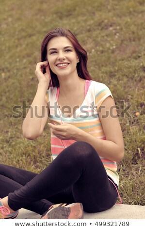 Happy long legged teenage girl has fun with music Stock photo © darrinhenry