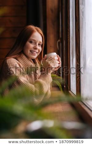 Ritratto accogliente giovane ragazza piedi finestra home Foto d'archivio © HASLOO