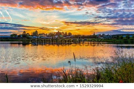 Hajnal folyó vitorlázik jacht horgony égbolt Stock fotó © bobhackett