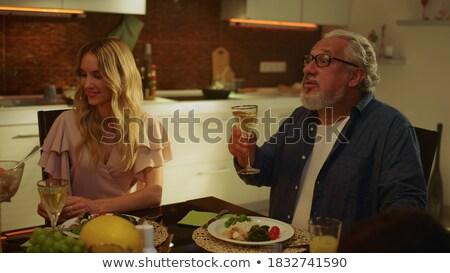 голодный · молодым · человеком · сидят · таблице · глядя · пончик - Сток-фото © photography33