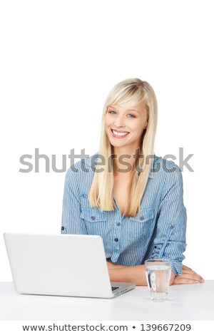 Blond woman sat at desk with laptop computer Stock photo © photography33