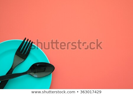 blue bowl with plastic spoon and fork stock photo © happydancing