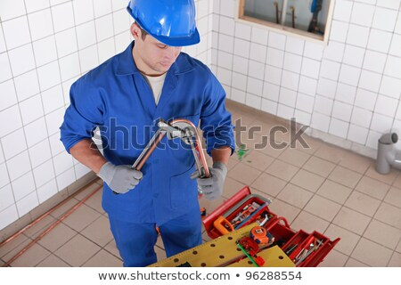 Plumber bending copper pipe Stock photo © photography33