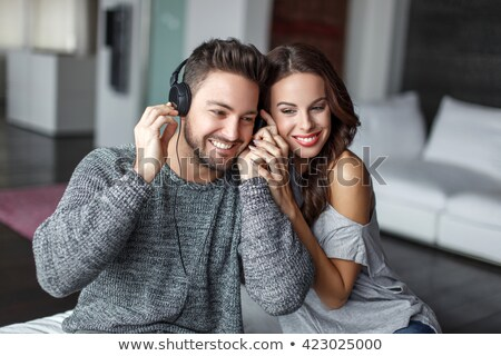 Young couple listening to an MP3 player Stock photo © photography33