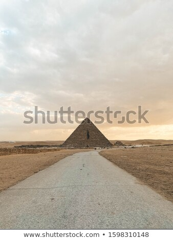 sphinx and pyramid in cairoegypt stock photo © bbbar