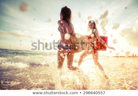 mulher · guarda-sol · biquíni · oceano · azul - foto stock © photography33
