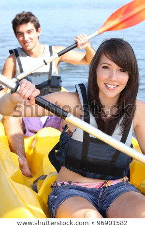 couple kayaking on a warm summers day stock photo © photography33