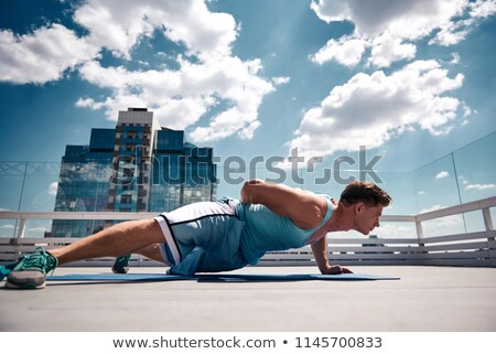 All muscles of sportsman is strained on Stock photo © vetdoctor