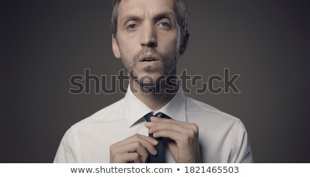 young businessman adjusting tie before interview stock photo © photography33
