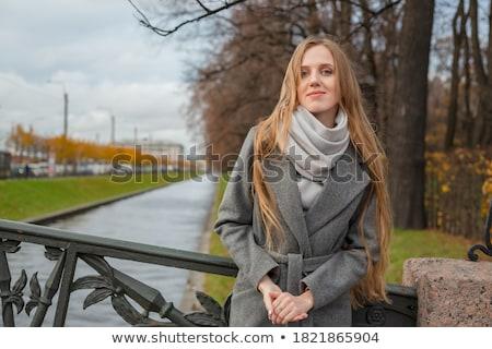 Beautiful woman near metal fence Stock photo © Massonforstock