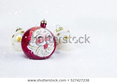santa claus figurine and christmas balls stock photo © photosebia