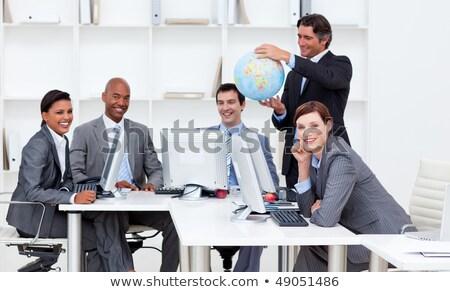 Zakenman glimlachend wereldwijde business glimlach internet wereldbol Stockfoto © wavebreak_media