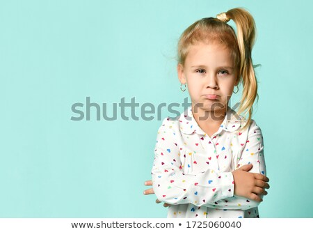 cheerful blonde showing her forefinger Stock photo © acidgrey