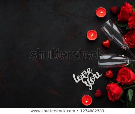 Stockfoto: Twee · champagne · bril · brief · rozenblaadjes · geïsoleerd