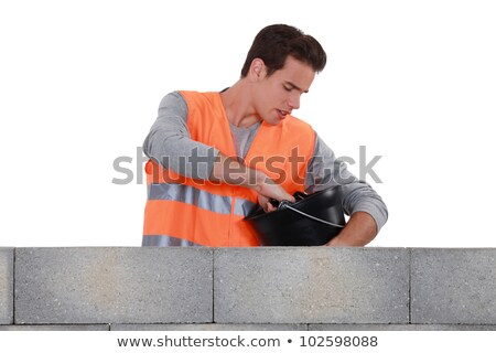 mason stood by wall with bucket stock photo © photography33