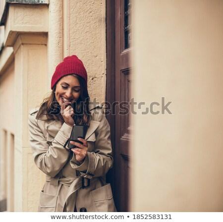 Kadın mesajlaşma erkek arkadaş yeni hareketli bakıyor Stok fotoğraf © stockyimages