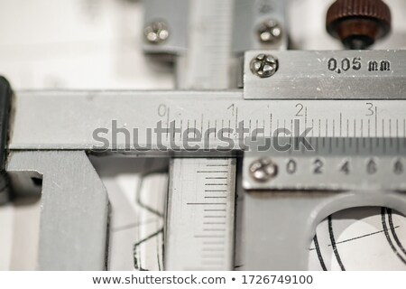 Caliper and finished parts on drawing Stock photo © icefront